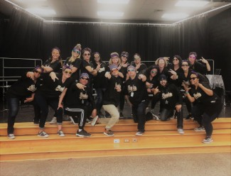 Teachers in Ponder attire act silly for their students
